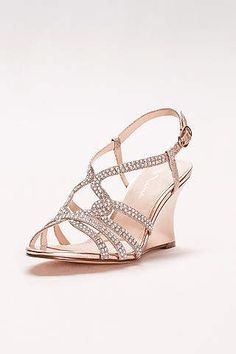 Metallic straps and tiny crystals make for an eye-catching combo on these  comfy wedges. By Touch of Nina Synthetic 3 heel Adjustable buckle Imported 1dd33d123c