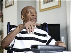 """Herbert W. Jones, left, who is one of only a few surviving Buffalo Soldiers in the country, talks about his service in the Army's all-black 92nd """"Buffalo Soldier"""" Division to Bud Fisher, right, while he records it on tape on September 28, 2011. Mr. Fisher has interviewed many veterans as part of a national project."""