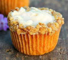 Carrot Pineapple Cupcakes A moist carrot cake cupcake with a dollop of pineapple cream cheese in the center. Topped with cream Cheese frosting and decorated with crushed walnuts. Delicious! !