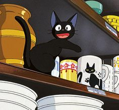 "Jiji finds a cup with a black cat resembling himself. From Hayao Miazaki's wonderful ""Kiki's Delivery Service"" via studio ghibli ""hey look it's me! Hayao Miyazaki, Kiki Delivery, Kiki's Delivery Service, Personajes Studio Ghibli, Anime Manga, Anime Art, Film Animation Japonais, Howl's Moving Castle, Le Vent Se Leve"
