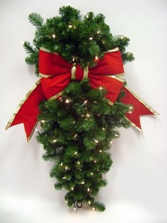 """$56.99-$106.99 48"""" Pre-lit Olympia Column Hanging Christmas Wreath w/ 18"""" Red Bow #177898 - Pre-lit Olympia Column Hanging Christmas Wreath  By GKI/Bethlehem Lighting Item #177898 Lighting up your holiday season is easy with this hanging wreath   Illunimated with 50 miniature lights set against a background of green PVC foliage  Also features an 18"""" red bow No matter how you decorate just plug i ..."""