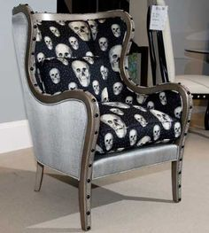 Braeden Accent Chair by Parker Southern. The skull fabric is limited time only - currently still available in April 2015. I'm having one made in a similar style to the one pictured here with the skulls on the exterior and a deep black on the interior. Comes with a throw pillow. Going to get rid of it in favor of a red lips or rose pillow.