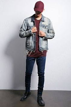 A denim jacket by Jordan Craig™ featuring a distressed design, zip-up front, basic collar, two front flap button chest pockets, two front slit pockets, and a destroyed hem.