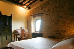 Superior Room La Postierla - it has a panoramic window on the countryside and stone walls. Bathroom with bath-tub. (20MQ)