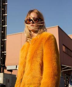 fuzzy faux fur winter jacket + vintage style oval sunglasses