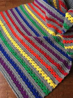Rainbow Crocheted baby blanket. This is a very special handmade crochet baby blanket.  This baby afghan will make a wonderful baby shower gift.  This blanket would make a lovely addition to your baby nursery decor. Perfect also, for travel, strollers, prams, cribs, tummy time and photo props