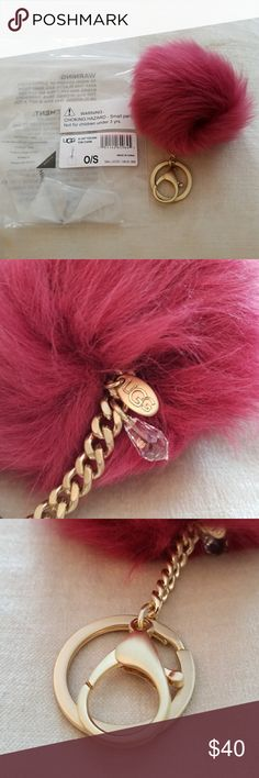 "UGG▪Toscana Crystal Pom Charm▪New in Package! Authentic Ugg raspberry colored pi.   Toscana sheepskin. Metal and Swarovski® crystal charms. Attached split key ring and metal lobster clasp. 1.38"" length. UGG Accessories"