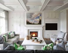 Hidden Tv Over Fireplace - Design photos, ideas and inspiration. Amazing gallery of interior design and decorating ideas of Hidden Tv Over Fireplace in bedrooms, living rooms, decks/patios by elite interior designers. White Fireplace Mantels, Fireplace Bookcase, Tv Over Fireplace, Fireplace Built Ins, Brick Fireplace, Fireplace Surrounds, Fireplace Design, White Mantel, Modern Fireplace