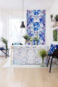 Kielo cushion and Naimakauppa coated fabric and Naimakauppa fancy curtain by Tanja Orsjoki, Loitsu curtain  and Riimu rug by Matleena Issakainen