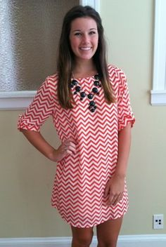 889047399bbdd Chevron Dress and bubble necklace. Obsessed with this look. Kim Shepard · Chevron  dresses (red and white)