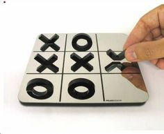 X O.    A reflective tic-tac-toe. Those are only half shapes, which reflect from the surface and creating the whole shapes.