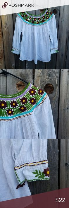 Floral Embroidered Bohemian Top No tags, appears to be S/M Excellent condition  Feel free to ask me any additional questions! Reasonable offers are considered. No trades, or modeling. Happy Poshing! Tops
