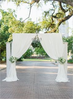 ceremony location created with pipe & drape, suspended chandelier, and columns