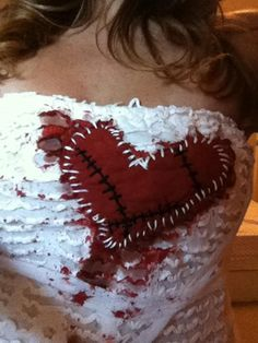 Bloody stitched heart. Was fun & easy to modify this costume.