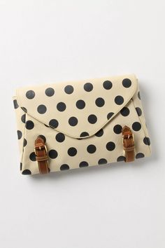 polka-dot leather clutch.
