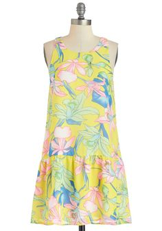 This sunny drop-waist frock knows the meaning of fun in the sun!