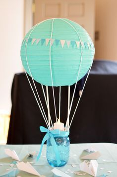 """""""in the air"""" baby shower Beautiful baby shower centerpiece idea. Hot air balloon anchored to a Mason jar! """"in the air"""" baby shower Beautiful baby shower centerpiece idea. Hot air balloon anchored to a Idee Baby Shower, Mesas Para Baby Shower, Shower Bebe, Baby Boy Shower, Baby Shower Gifts, Baby Gifts, Baby Party, Baby Shower Parties, Baby Shower Themes"""