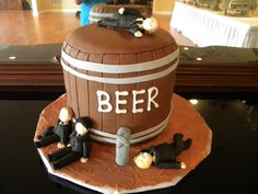 beer keg cake with drunken grooms men  www.confectionperfectioncakes.com  #groomscake #cakesatlanta #cakesmarietta #weddingcake #customcakes #atlantacustomcakes #mariettacustomcakes #confectionperfection #kegcake #beercake #groomsmencake