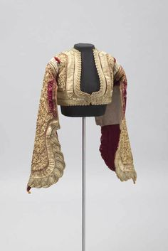 Jacket, Corfu Greece, 1880-1980: Short, fitted jackets were fashionable for men and women in 19th century Greece. Embroidering with metal thread is a long tradition in Greece that was profoundly influenced by centuries of Ottoman rule.