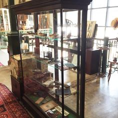 glass, brass and wooden display cabinet: available for purchase at Uncommon Market Dallas, 100 Riveredge Drive, Dallas, Texas 75207; call us @ 214-871-2775 if you would like to put this item on a 2 day HOLD.