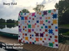I'm happy to be back at the Bake Shop with a fun, star-filled, queen sized quilt. This project uses the new Bella Solids colors. There are a wide variety of colors in this bundle, and I wanted somethi