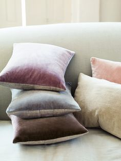 Fronted in luxuriously soft velvet, with a natural colour linen back and three mother-of-pearl buttons, each of our Velvet & Linen Cushions come complete with a high quality cushion pad made from feather and down. Available in a collection of different eye-catching shades, they look beautiful displayed alone or all together on a sofa, armchair or bed. Soft Blush, a pearly feminine soft pink colour that works well as an accent colour for simple interiors.