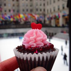 Valentine's day is right around the corner, and I wanted to make some festive cupcakes for my coworkers. I ended up making dark chocolate cupcakes with a raspberry compote filling, pink vani…