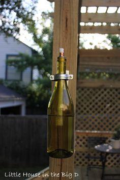 oil lamp from wine bottle for outside in the garden