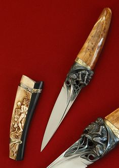 """Arpad Bojtos - Name: """"Hercules and the Nemean Lion"""" Materials: Blade: 440 C Handle: fossil walrus ivory, gold [14 car], small diamonds Sheath: moose antler, buffalo horn, silver, gold Description: Full carved integral. The total lenght of the knife is 26 CMs."""