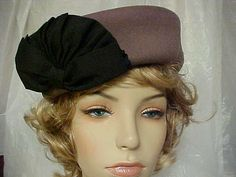 Toupe pillbox hat 100  wool  with a black grosgrain by designer2, $25.00