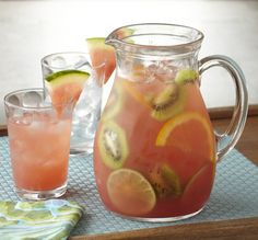 Watermelon Blush Sangria ~ 2 Cups sliced fruit (such as limes, oranges and kiwi), 1 bottle of Watermelon Mojito Mixer, 1 750 mL bottle white wine (such as Sauvignon Blanc), Soda Water to taste, Watermelon wedges for garnish