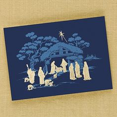Majestic Manger Religious Card Celebrate the birth of Jesus with style and grace. Impeccable embossing in glistening gold foil against a majestic blue illustration captures His birth beautifully