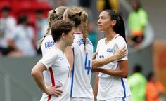 Christen Press and teammates after Press missed her penalty kick vs. Sweden, Aug. 12, 2016. (Eraldo Peres/AP)