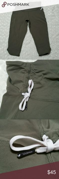"""Lululemon Army Green Cinch Waist Crop Pants Condition is very good - minimal wear - no snags - can be worn cinched or uncinched for high waist - size tag missing but I believe they're a 6 or 8 - total length uncinched 27"""" - inseam 17"""" - rise uncinched 9.5"""" - waistband 14.5"""" across the very top laying flat  KW's - fatigue, cropped, capri, tie, side, dolphin, hem, gusset, waisted, highwaist, highwaisted, combat lululemon athletica Pants Ankle & Cropped"""
