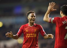 LONDON, ENGLAND - Sunday, December 15, 2013: Liverpool's Raheem Sterling celebrates scoring the fifth goal against Tottenham Hotspur during the Premiership match at White Hart Lane. (Pic by David Rawcliffe/Propaganda)