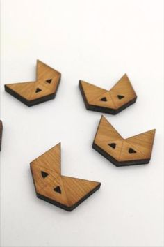 These lovely little fox faces are inspired by the geometry of origami. Designed and made by Arrow Mountain. #BeyondMeasure #ArrowMountain #buttons #wooden #fox Fox Face, Little Fox, Geometry, Arrow, Origami, Bamboo, Mountain, Faces, Symbols
