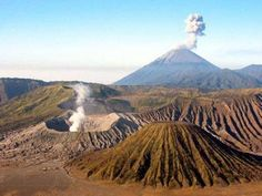 The Bromo-Tengger-Semeru National Park is a reserve consisting of a group of (mostly) active volcanoes in Tengger, East Java - Indonesia. A nature reserve since 1919, it consists of Mount Batok (Indonesian: Gunung Batok) that is dormant in the foreground, Mount Bromo (Indonesian: Gunung Bromo) that is belching sulphur to the left, and Mount Semeru (Indonesian: Gunung Semeru) that is erupting in the distance.