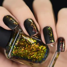 """""""Nail art using our vibrant Ultra Chrome Flakies Glory and Brilliance over a matte black base! The 2015 Fall Collection will be available at 11AM PST! """""""