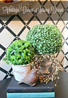 Create a charming vignette to welcome spring with moss balls, vintage books and a sweet wreath.
