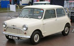 1959 Morris Mini-Minor.  Introduced in April 1959.  1 of 3 models for the year.  4-speed manual gearbox.  848cc engine. 10 ft long, 4 ft 7 in wide.  4 seats.