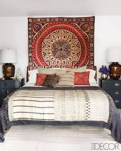 Grey's Anatomy star Ellen Pompeo enlisted designer Martyn Lawrence-Bullard to create a well-traveled look for her Hollywood Hills bedroom. Pompeo found the bed at one of her favorite Parisian stores, Caravane Chambre 19, and accessorized it with an antique Egyptian wall hanging, Moroccan-style brass lamps, an Indian throw, and 1950s West African pillows from Hollywood at Home.  Tour the rest of the home here.