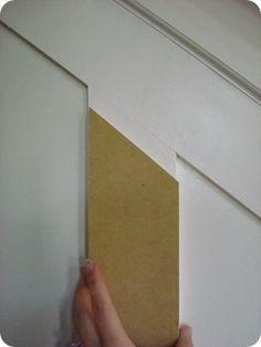 Great board and batten tutorial for stairs by Thrifty Decor Chick