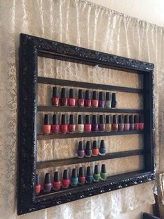 This beautiful frame is hand carved from Italy and is made to display around 95 bottles of nail polish. It measures 30x 25 and is painted in a semi