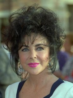 This is a 1992 photo of actress Elizabeth Taylor in Los Angeles.  (AP Photo/ Kevork Djansezian)