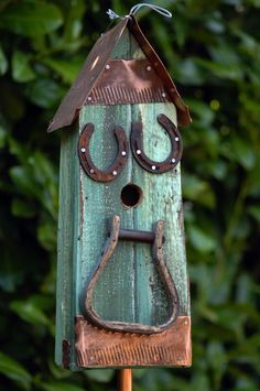 Cute birdhouse with horseshoes and stirups