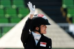 Singapore's Gemma Rose Foo waves after competing in the dressage team test (grade 1a) in the Paralympic Games at the Olympic Equestrian Centre in Rio de Janeiro on September 12, 2016. / AFP / YASUYOSHI CHIBA