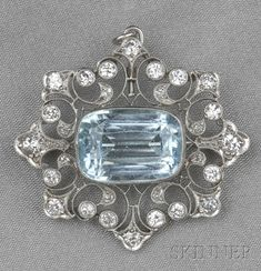 Edwardian Platinum, Aquamarine, and Diamond Pendant/Brooch, bezel-set with a fancy-shape aquamarine measuring approx. 15.10 x 10.70 x 8.40 mm, further set with old European- and single-cut diamonds, approx. total wt. 1.20 cts., millegrain accents, lg. 1 1/2 in.