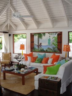 Bright tropical beach house interior, love the bird of paradise color pillows & natural accents