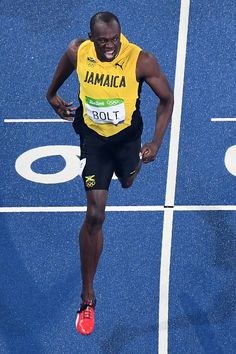 Jamaica's Usain Bolt crosses the finish line to win the Men's 200m Final during…