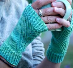Free knitting pattern for Straightforward Mitts with diagonal rib pattern on both sides and more wristwarmer knitting patterns
